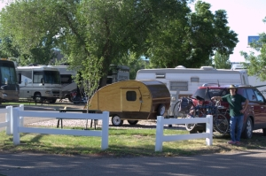 """If you see the """"Woodstock"""" Teardrop trailer on the road, that's us heading to our next art show! Here's Dave at the Century RV Park in Ogden Utah. We were rocking the tiny trailer thing in the midst of behemoths!"""