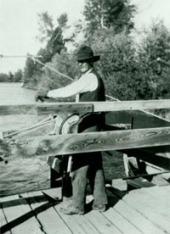 Bill Menor operating his ferry